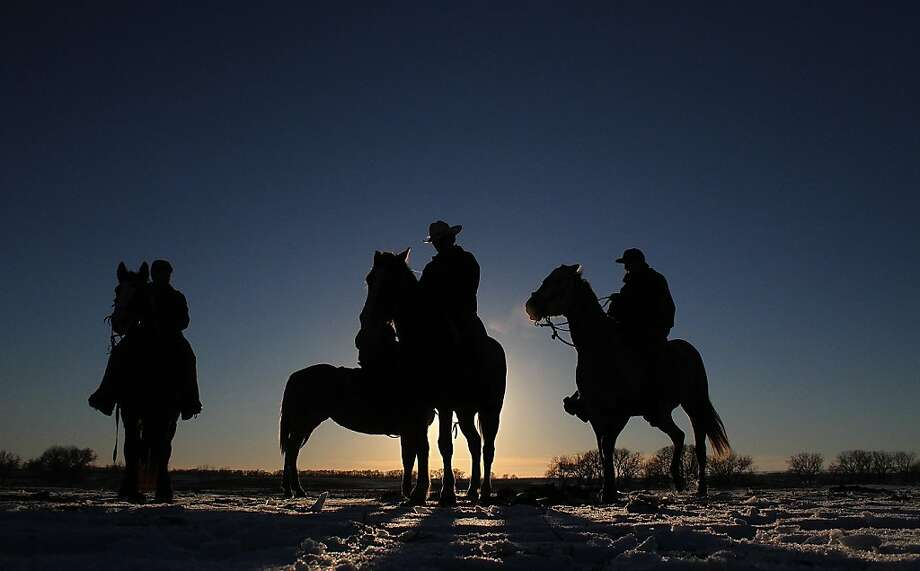 In this Dec. 12, 2012, photo, riders participate in the Dakota 38 Plus 2 memorial ride near Woonsocket, South Dakota. The riders left from Crow Creek and are expected to arrive Tuesday in Mankato, Minn. (AP Photo/Daily Republic, Chris Huber) Photo: Chris Huber, Associated Press
