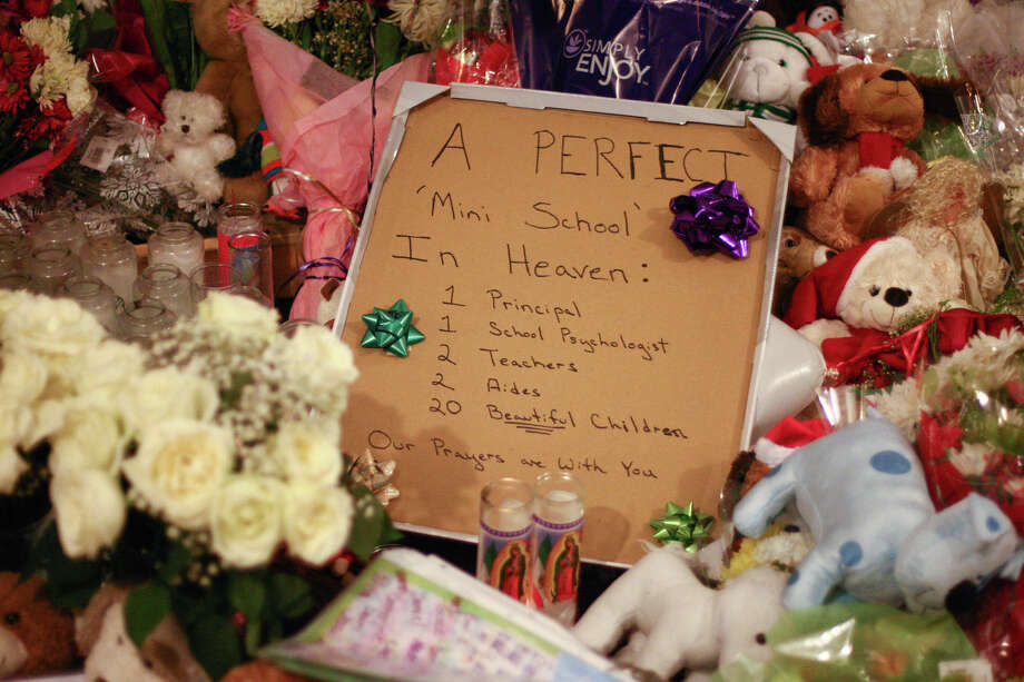 A sign is shown at the Sandy Hook memorial on Saturday, December 22, 2012. Photo: JOSHUA TRUJILLO / HEARST NEWSPAPERS