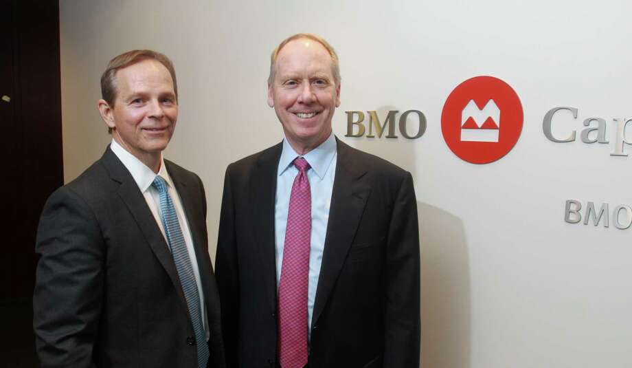 (For the Chronicle/Gary Fountain, November 28, 2012)  Tod Benton, managing director and head of the BMO Capital Markets U.S. Energy group, left, and Bill Downe, president and CEO of BMO Financial Group. Photo: Gary Fountain, Freelance / Copyright 2012 Gary Fountain.