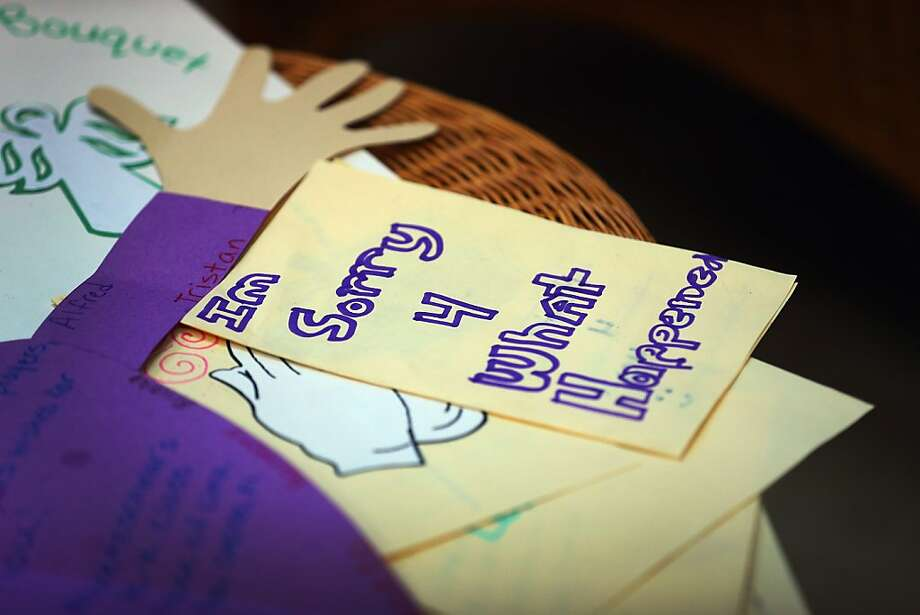 MIAMI, FL - DECEMBER 21:  A card written by a student at St. Rose of Lima School reads, ''Im Sorry 4 What Happened'' on a card to be sent to the victims of  the school shooting in Newtown, Connecticut on December 21, 2012 in Miami, Florida. Across the country people marked the one week point since the shooting at Sandy Hook Elementary School in Newtown, Connecticut that killed 26 people.  (Photo by Joe Raedle/Getty Images) Photo: Joe Raedle, Getty Images