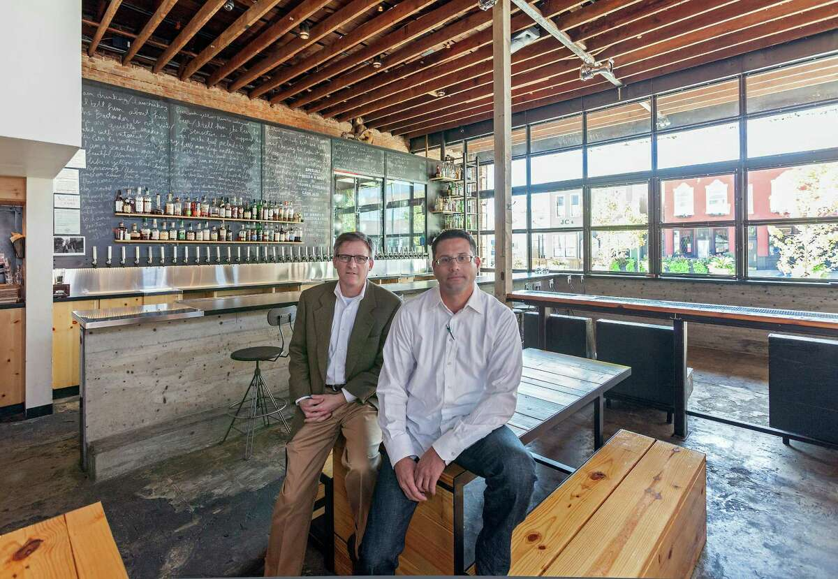 """Larry Margolis, left, and Ian Rosenberg were leaders in converting a 1915 building at 1011 McGowen into a craft beer and cocktail bar called Mongoose versus Cobra. """"I don't want what we do to slap you in the face and say 'look at me,'"""" Rosenberg says."""