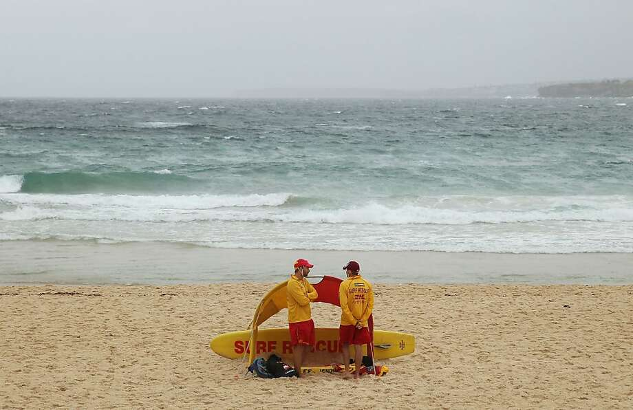 SYDNEY, AUSTRALIA - DECEMBER 25:  Lifesavers keep watch over a near deserted beach at Bondi Beach on December 25, 2012 in Sydney, Australia.  Traditionally beaches such as Bondi Beach are popular destinations for tourists and locals alike to celebrate Christmas Day.  (Photo by Don Arnold/Getty Images) Photo: Don Arnold, Getty Images