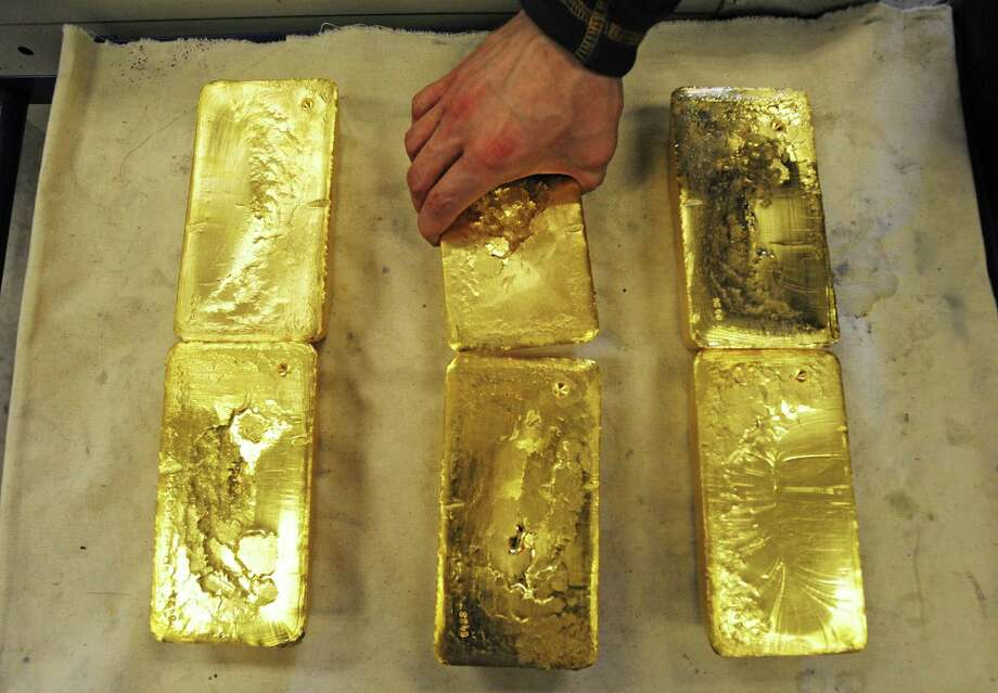 Ten-kilogram gold bars are handled at an Austrian gold bullion factory. Texas will become the first U.S. state to have its own gold depository. Photo: JOE KLAMAR, Staff / AFP