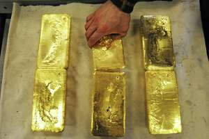 Ten-kilogram gold bars are handled at an Austrian gold bullion factory. Scott Burns says he trust golds more than he trusts government paper or government policy.