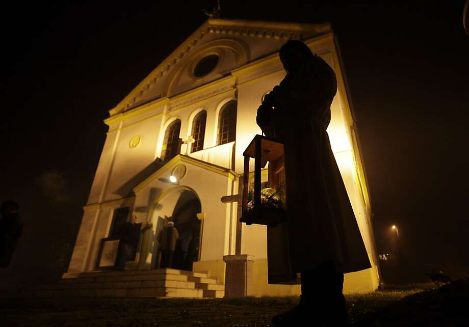 Bosnian Croat girl holds candle welcoming worshipers to attend a Christmas Mass at a church in the village of Morancani, near Tuzla 70 kilometers (43 miles) north of Sarajevo, Bosnia, Tuesday, Dec. 25, 2012.(AP Photo/Amel Emric) Photo: Amel Emric, Associated Press