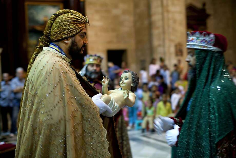 Puerto Rican citizens perform as the Three Kings during a Mass to reenact Jesus Christ birth during Christmas celebrations at the Cathedral in Havana, Cuba, Monday, Dec. 24, 2012. (AP Photo/Ramon Espinosa) Photo: Ramon Espinosa, Associated Press