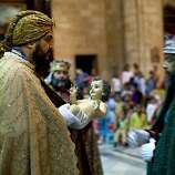 Puerto Rican citizens perform as the Three Kings during a Mass to reenact Jesus Christ birth during Christmas celebrations at the Cathedral in Havana, Cuba, Monday, Dec. 24, 2012. (AP Photo/Ramon Espinosa)