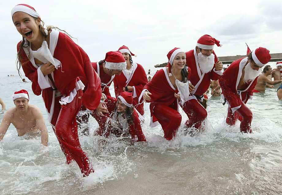 People dressed up as Santa Claus enjoy a traditional Christmas bath on December 23, 2012 in Monaco. AFP PHOTO / VALERY HACHEVALERY HACHE/AFP/Getty Images Photo: Valery Hache, AFP/Getty Images