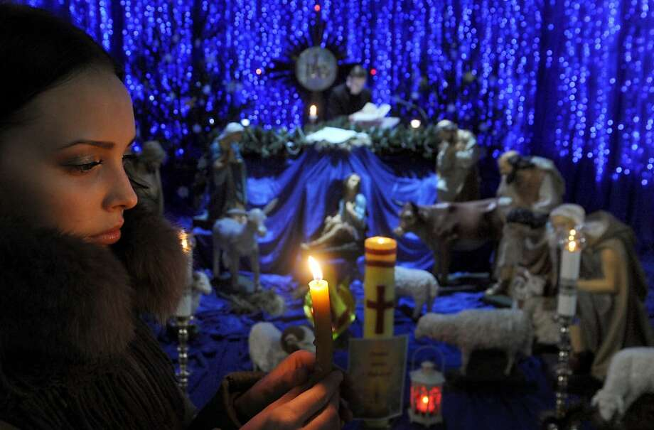 A girl holds a candle during a carol service at the Red Catholic Church in Minsk, on December 24, 2012. AFP PHOTO / VIKTOR DRACHEVVIKTOR DRACHEV/AFP/Getty Images Photo: Viktor Drachev, AFP/Getty Images