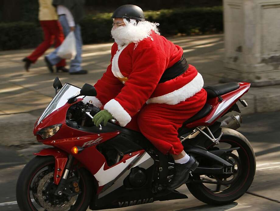 A man disguised as Santa Claus rides a motorcycle in Mexico City, Sunday, Dec. 23, 2012. (AP Photo/Marco Ugarte) Photo: Marco Ugarte, Associated Press