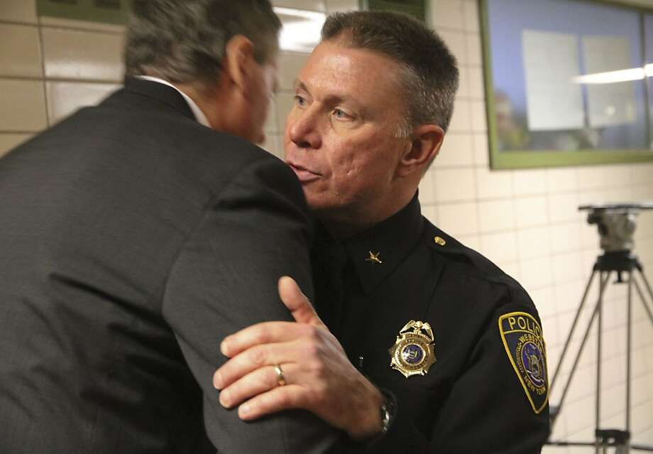 WEBSTER, NY - DECEMBER 24:  Webster Police Chief Gerald Pickering (R) embraces New York State Lt. Gov. Robert Duffy following a news conference concerning the two firefighters killed, and two injured in a presumed ambush attack December 24, 2012 in Webster, New York. Authorities say an ex-con gunned down two firefighters after setting a car and a house on fire early Monday, then took shots at police and committed suicide while several homes burned.  (Photo by Guy Solimano/ Getty Images) Photo: Guy Solimano, Getty Images