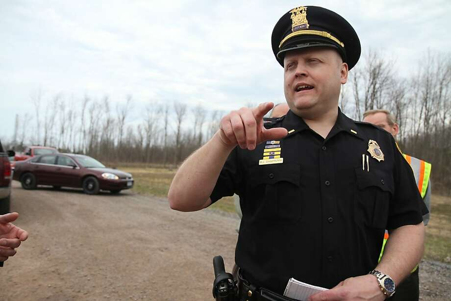 In this photo taken April 11, 2011, Lt. Michael Chiapperini with the Webster Police Department speaks to the media about the accidental death of a man working underground on the Monroe County Water Authority site in Webster, N.Y. on Lake Road near Basket Road. A former convict set a house and car ablaze in his lakeside New York state neighborhood to lure firefighters then opened fire on them, killing two, including Chiapperini, and engaging police in a shootout before killing himself while several homes burned. Authorities used an armored vehicle to evacuate the area. (AP Photo/Democrat & Chronicle, Tina Yee)  MAGS OUT; NO SALES Photo: Tina Yee, Associated Press