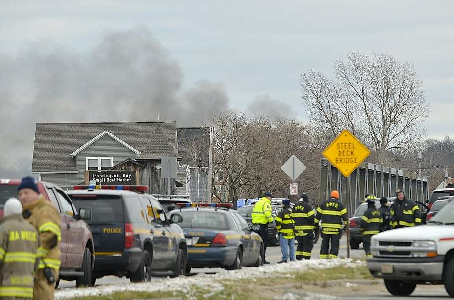 Smoke is seen from the site of a fire in Webster, N.Y., Monday, Dec. 24, 2012. Police in New York state say a man who killed two firefighters in a Christmas Eve ambush had served 17 years for manslaughter in the death of his grandmother.  (AP Photo/Seth Binnix) Photo: Seth Binnix, Associated Press