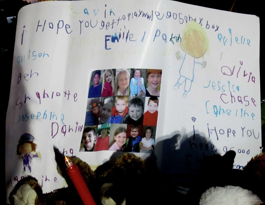 This is one of the messages sent by children to the kids in Sandy Hook, Conn., where 20 students and six school staff members were killed at their elementary school Dec. 14. This picture was taken the evening of Dec. 24, a day when homes across Newtown lit 26 luminaries at 5 p.m. to remember the victims. Photo: Casey McNerthney/Hearst Newspapers