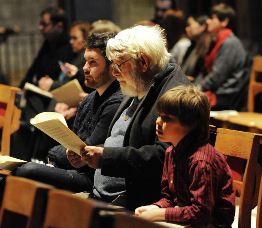 From left, Patrick Bush of Queens, Brian Bush of Albany and James Bush, 10, of Albany attend an early Christmas Eve Mass at The Cathedral of All Saints on South Swan St.  on Monday Dec. 24, 2012 in Albany, N.Y. (Lori Van Buren / Times Union) Photo: Lori Van Buren