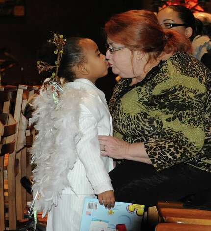 Daylon Jackson, 3, gives her grandmother Ginny Weeks both of Albany a kiss as they attend an early Christmas Eve Mass at The Cathedral of All Saints on South Swan St.  on Monday Dec. 24, 2012 in Albany, N.Y. (Lori Van Buren / Times Union) Photo: Lori Van Buren
