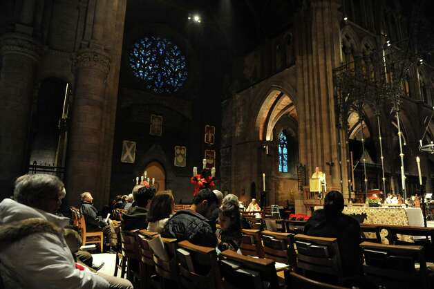 People attend an early Christmas Eve mass at The Cathedral of All Saints on South Swan St.  on Monday Dec. 24, 2012 in Albany, N.Y. (Lori Van Buren / Times Union) Photo: Lori Van Buren