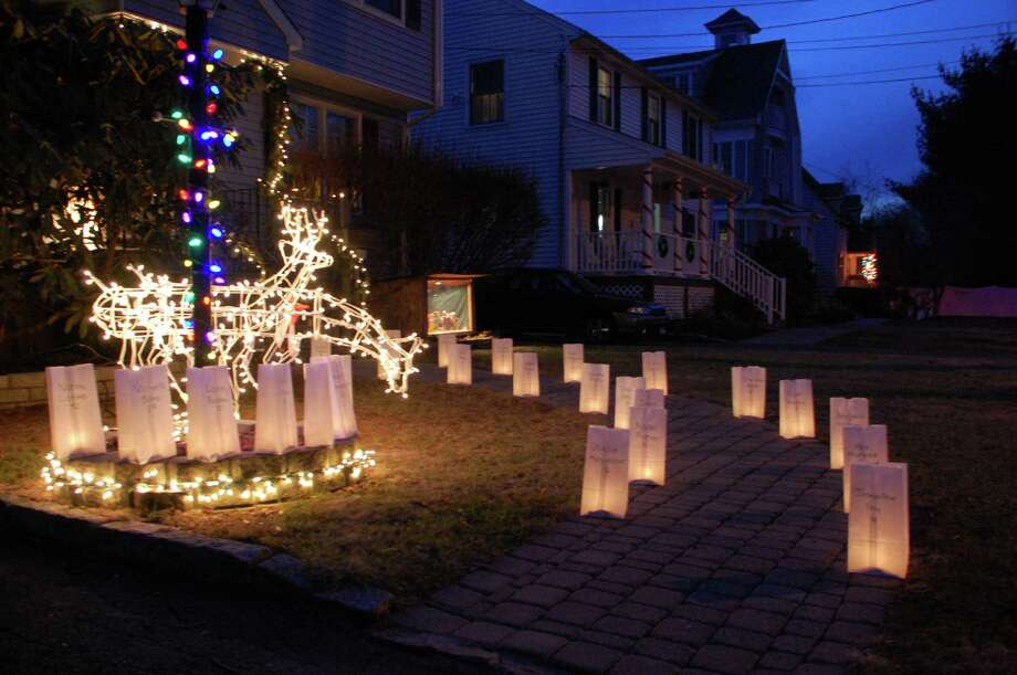 The Gosp house on Lalley Boulevard, one of many neighborhood homes with 26 luminaries lighted Monday night in memory of the victims in the Sandy Hook Elementary School shooting.  Fairfield CT 12/24/12 Photo: Jarret Liotta / Fairfield Citizen contributed
