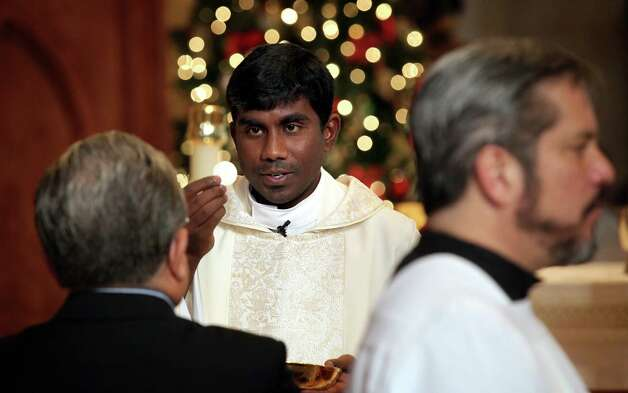 Fr.Prasanna Mese celebrates Christmas Mass at San Fernando Cathedral during the 9 A.M service.  Tuesday, Dec. 25, 2012. Photo: Bob Owen, San Antonio Express-News / © 2012 San Antonio Express-News