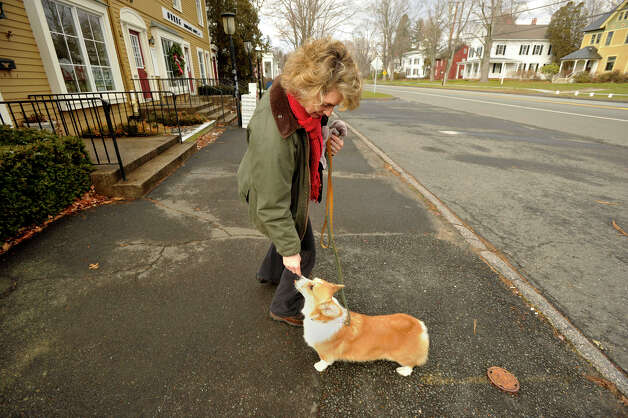 Karen Boyle gives her dog, Lorelei, a treat while walking down Main Street in Newtown on Tuesday, Dec. 25, 2012. Photo: Jason Rearick / The News-Times