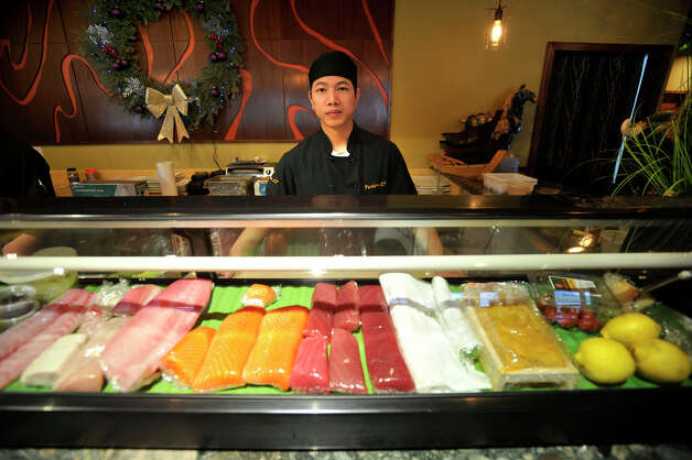 Chef Jimmy Zheng stands behind the sushi counter at Fusion 25 in Newtown on Tuesday, Dec. 25, 2012. The newly opened Fusion 25 stayed open on Christmas. Photo: Jason Rearick / The News-Times