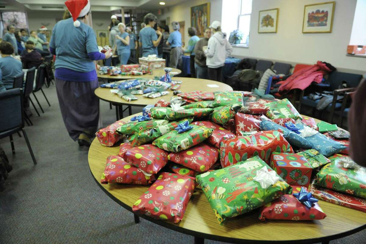 A table of gifts wrapped by volunteers is seen during the Christmas Mitzvah/Holiday Meals Program at Congregation Berith Sholom on Tuesday, Dec. 25, 2012 in Troy, NY. For 19 years the congregation's members have been spending Christmas preparing meals, wrapping gifts, making holiday cards and delivering the items to shut-ins around the greater Troy area and to homeless shelters in the city. Organizers said that this year they will deliver the meals and gifts to 380 people, an increase of over 100 people in the last two years. The over 160 households that make up the congregation take part all year long buying gifts and collecting items and donating money towards the meals program. (Paul Buckowski / Times Union)