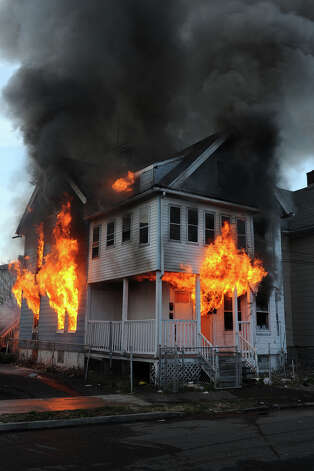 A house burns on Olive Street, in Bridgeport, Conn. on, Dec. 24th, 2012. The fire was one of three suspicious fires that broke out in a short period of time on Christams Eve afternoon. Photo: Ned Gerard