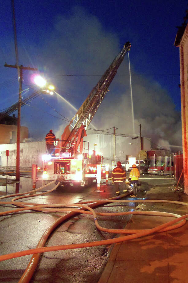 Firefighters battled a blaze all day at 33 Knowlton St. on Dec. 24, 2012. The fire destroyed a one-story industrial building on Bridgeportís east Side that was constructed in 1930. Photo: John Burgeson