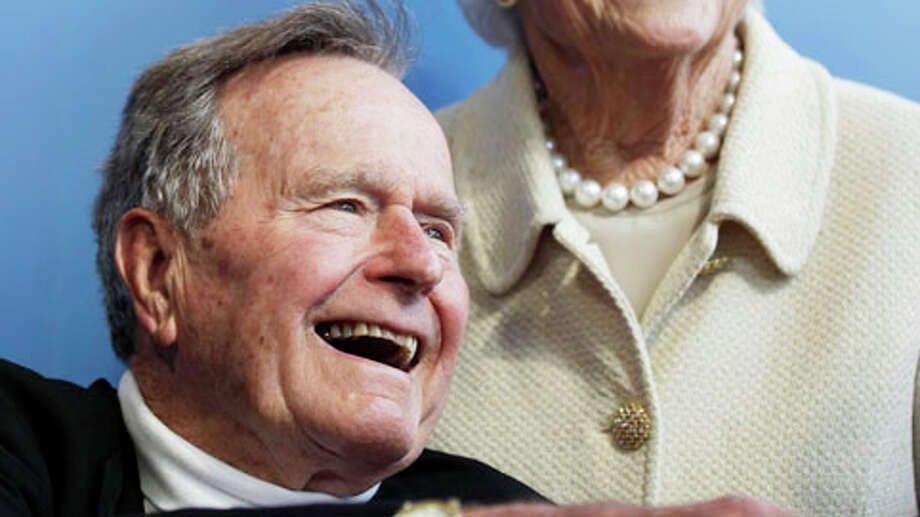 FILE - In a Tuesday, June 12, 2012 file photo, former President George H.W. Bush, and his wife former first lady Barbara Bush, arrive for the premiere of HBO's new documentary on his life near the family compound in Kennebunkport, Maine. The 41st president's month-long stay in a Houston hospital for treatment of a bronchitis-related cough appears to be nearing an end. A spokesman said Thursday, Dec. 20, 2012 that Bush possibly will be released from Methodist Hospital over the weekend and be home for Christmas. Photo: Charles Krupa, . / AP