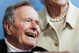FILE - In a Tuesday, June 12, 2012 file photo, former President George H.W. Bush, and his wife former first lady Barbara Bush, arrive for the premiere of HBO's new documentary on his life near the family compound in Kennebunkport, Maine. The 41st president's month-long stay in a Houston hospital for treatment of a bronchitis-related cough appears to be nearing an end. A spokesman said Thursday, Dec. 20, 2012 that Bush possibly will be released from Methodist Hospital over the weekend and be home for Christmas.