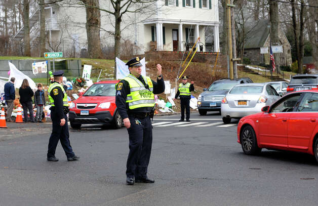 Police officers from other towns around the region came in to relieve Newtown officers on Christmas Day in Newtown, Conn. on Tuesday December 25, 2012. Photo: Christian Abraham / Connecticut Post