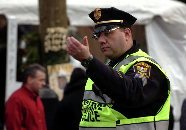Monroe police officer Sgt. Stephen Corrone directs traffic as he and other police officers from towns around the region came in to relieve Newtown officers on Christmas Day in Newtown, Conn. on Tuesday December 25, 2012. Photo: Christian Abraham / Connecticut Post