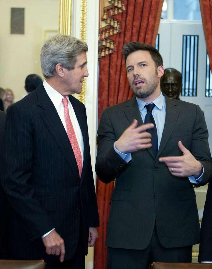 Sen. John Kerry D-Mass., speaks with actor Ben Affleck during a meeting with foreign relations members to discus the crisis in the Democratic Republic of Congo on Capitol Hill in Washington on Wednesday, Dec. 19, 2012. (AP Photo/Jose Luis Magana) Photo: Jose Luis Magana