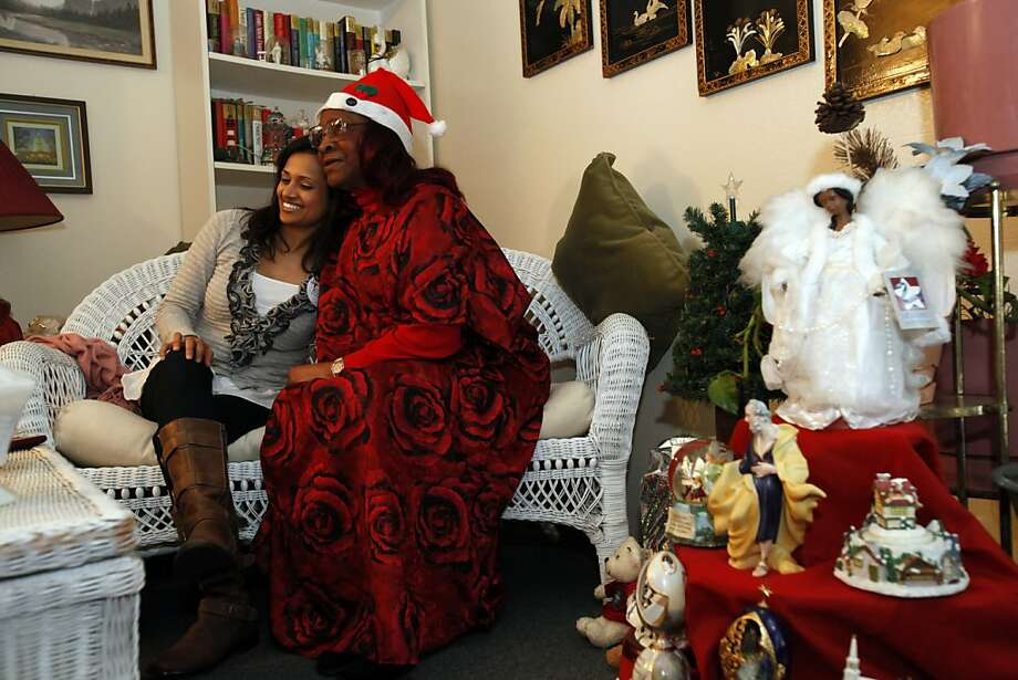 Dr. Ganga Nadella (left) gets a hug from Fannie Clarke at Clarke's apartment in the Tenderloin during a Christmas visit. Photo: Carlos Avila Gonzalez, The Chronicle