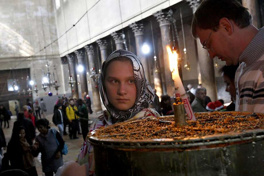 Christian attend Christmas day mass in the Church of Nativity, traditionally believed by Christians to be the birthplace of Jesus Christ, in the West Bank town of Bethlehem, Tuesday, Dec. 25, 2012.  Photo: Adel Hana, Associated Press