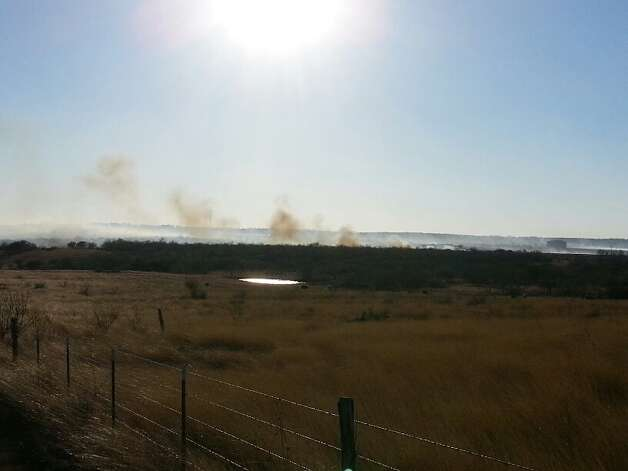 More than 100 firefighters from across the region worked to keep a grass fire contained in East Bexar County near Converse that caused police to block parts of Loop 1604. Photo: Michelle Mondo/Express-News