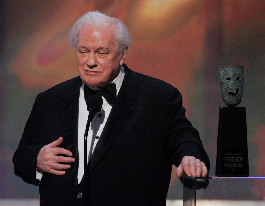 FILE - In this Sunday, Jan. 27, 2008 file photo, in Los Angeles file photo, actor Charles Durning accepts the life achievement award at the 14th Annual Screen Actors Guild Awards. Durning, the two-time Oscar nominee who was dubbed the king of the character actors for his skill in playing everything from a Nazi colonel to the pope, died Monday, Dec. 24, 2012 at his home in New York City. He was 89. (AP Photo/Mark J. Terrill) Photo: Mark J. Terrill