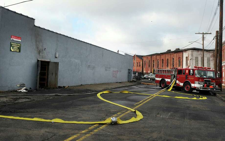 The scene of a fire at 33 Knowlton St. in Bridgeport Tuesday, Dec. 25, 2012. Photo: Autumn Driscoll / Connecticut Post
