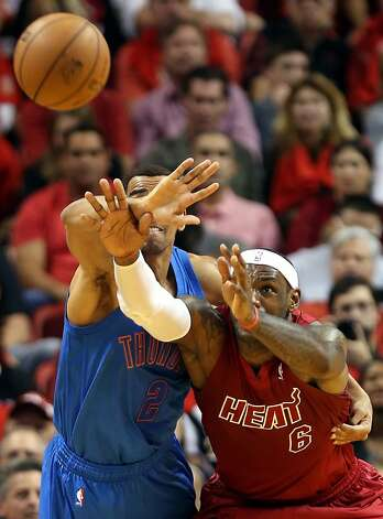 In this case, LeBron James' reach exceeds his grasp against Oklahoma City's Thabo Sefolosha. Photo: Marc Serota, Getty Images