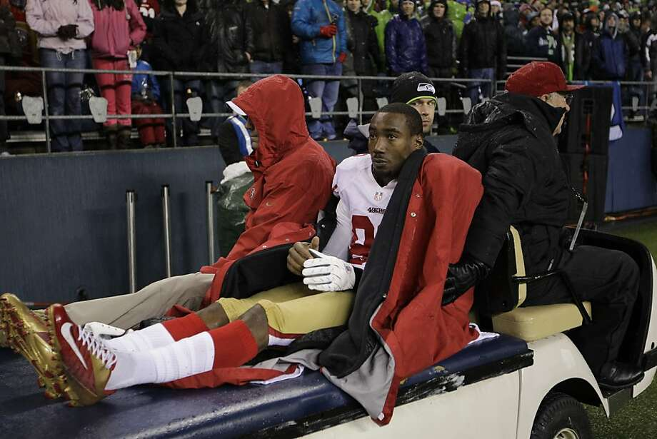 Mario Manningham's season-ending injury only added to the insult of the 49ers' 42-13 loss in Seattle on Sunday. Photo: John Froschauer, Associated Press