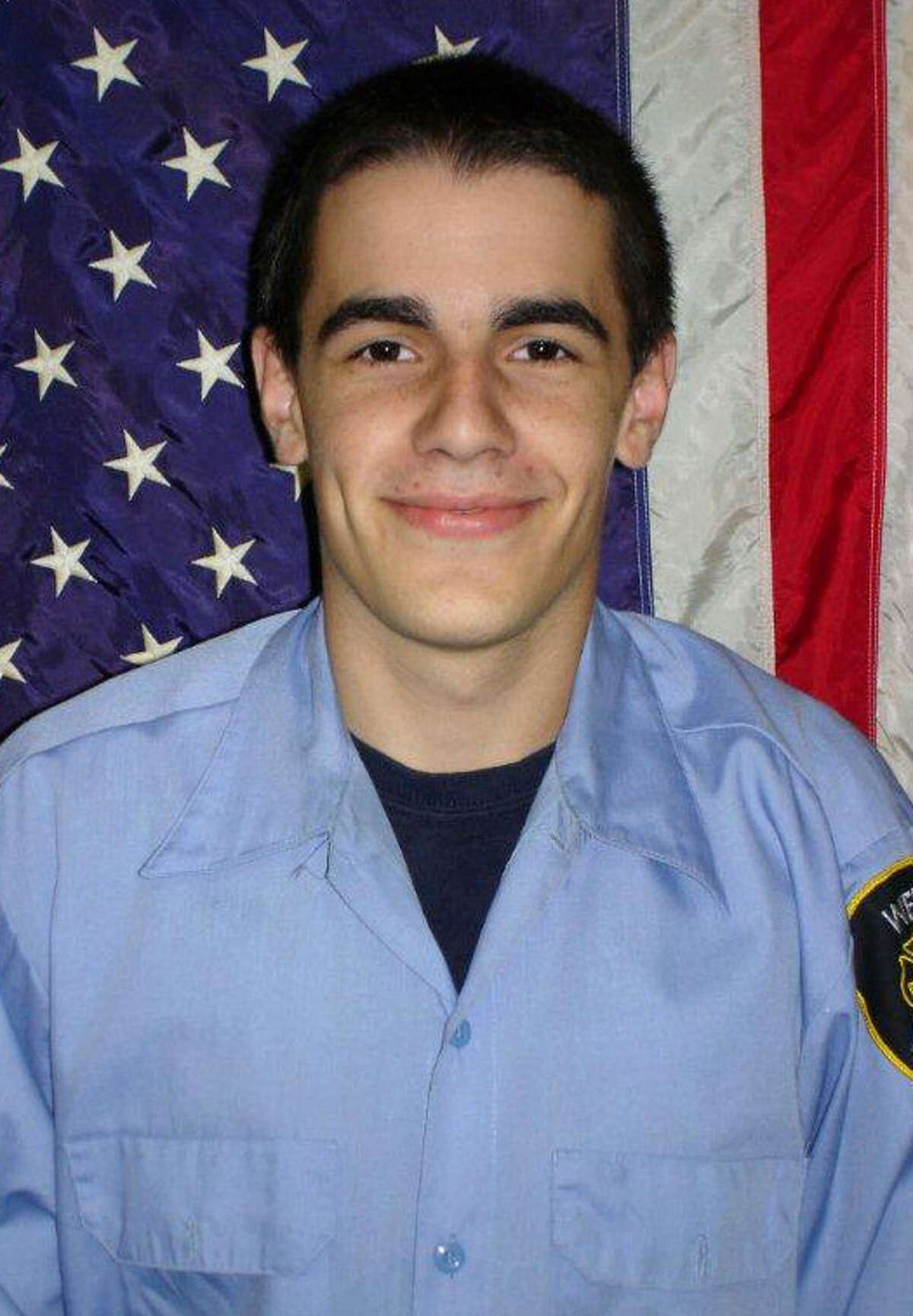 This undated image provided by the West Webster fire department shows firefighter Tomasz Kaczowka. Tomasz Kaczowka. 19, was killed when William Spengler, 62, who served 17 years in prison for the 1980 hammer killing of his grandmother, armed himself with a revolver, a shotgun and a semiautomatic rifle before he set his house on fire to lure first responders into a death trap before dawn Monday, Dec. 24, 2012. (AP Photo/West Webster Fire Department)