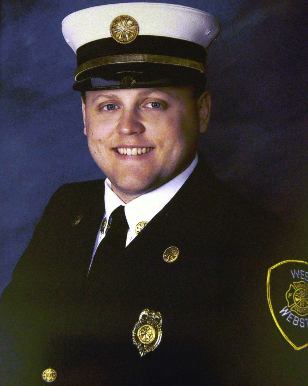 This undated image provided by the West Webster fire department shows firefighter Lt. Michael Chiapperini. Chiapperini, 43, also the Webster Police Department's public information officer, was killed when William Spengler, 62, who served 17 years in prison for the 1980 hammer killing of his grandmother, armed himself with a revolver, a shotgun and a semiautomatic rifle before he set his house on fire to lure first responders into a death trap before dawn Monday, Dec. 24, 2012. (AP Photo/West Webster Fire Department)
