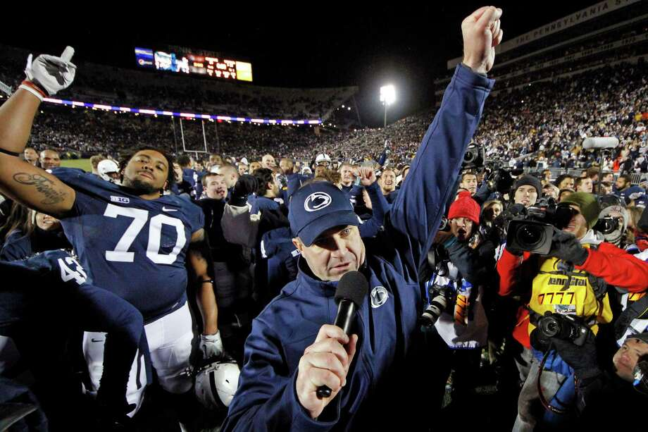 FILE - In this Nov. 24, 2012, file photo, Penn State head coach Bill O'Brien, center, celebrates with his team after their 24-21 overtime win over Wisconsin in an NCAA college football game in State College, Pa. The reverberations from the Penn State child sex abuse scandal was selected as the sports story of the year by United States editors and news directors in an annual vote conducted by The Associated Press, marking the first time that the same issue was selected in consecutive years since the AP began announcing a sports story of the year in 1990. (AP Photo/Gene J. Puskar, File) Photo: Gene J. Puskar