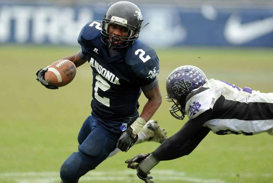 Ansonia's Arkeel Newsome carries the ball into the endzone as North Branford's Alex McGuigan defends during the Class S state football championship game Saturday, Dec. 8, 2012 at Rentschler Field in East Hartford, Conn. Photo: Autumn Driscoll / Connecticut Post