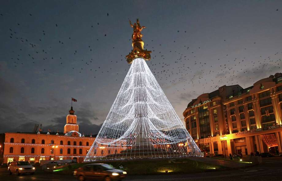 An illumination resembling a Christmas tree is set for New Year celebrations at St. George Monument in Freedom Square in Tbilisi, Georgia, Tuesday, Dec. 25, 2012. Photo: Shakh Aivazov, Associated Press / AP