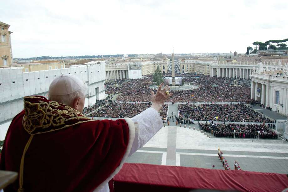 "Pope Benedict XVI delivers his traditional Christmas ""Urbi et Orbi"" blessing from the balcony of St. Peter's Basilica at the Vatican on December 25, 2012. Photo: OSSERVATORE ROMANO, AFP/Getty Images / AFP"