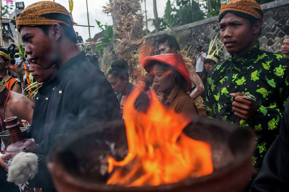 Incense burns as Indonesians attend a traditional Javanese Christmas mass in Klaten, Central Java, Indonesia, Tuesday, Dec. 25, 2012. Photo: Gembong Nusantara, Associated Press / AP