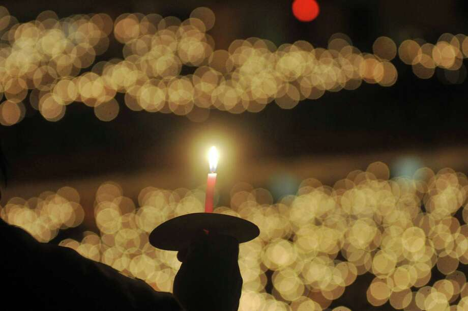 A Christian worshipper holds a candle while attending a Christmas service in Surabaya on December 25, 2012. Christians in Indonsia comprise about 10 percent of the world's largest Muslim-majority nation. Photo: JUNI KRISWANTO, AFP/Getty Images / AFP