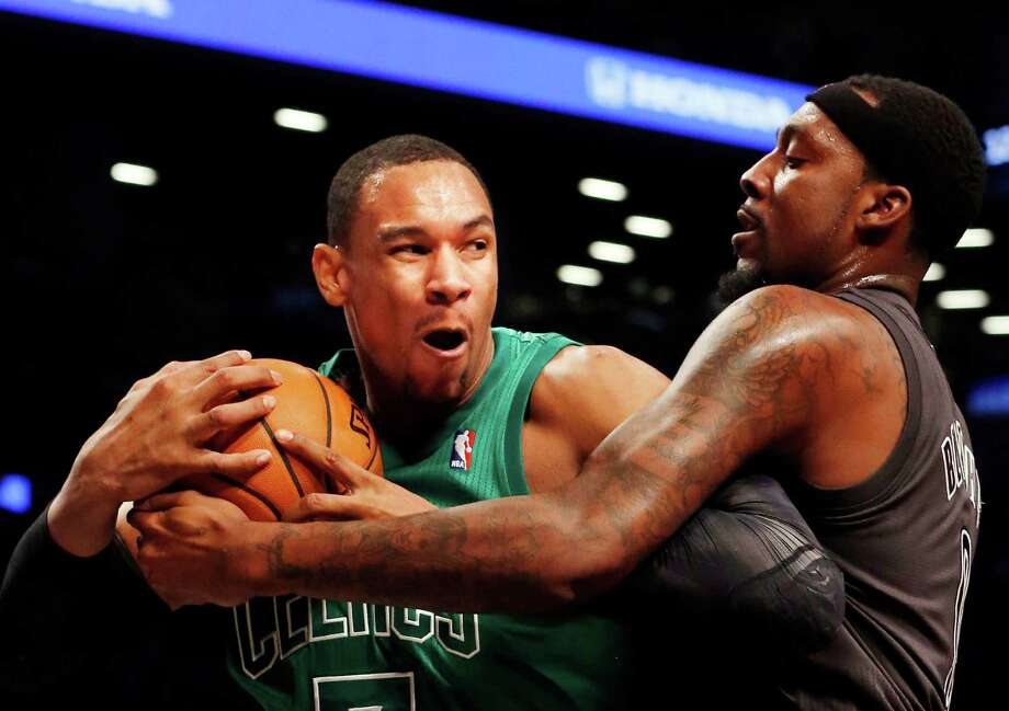 Boston Celtics forward Jared Sullinger (7) and Brooklyn Nets forward-center Andray Blatche (0) battle for the ball in the first half of their NBA basketball game at the Barclays Center, Tuesday, Dec. 25, 2012, in New York. (AP Photo/John Minchillo) Photo: John Minchillo
