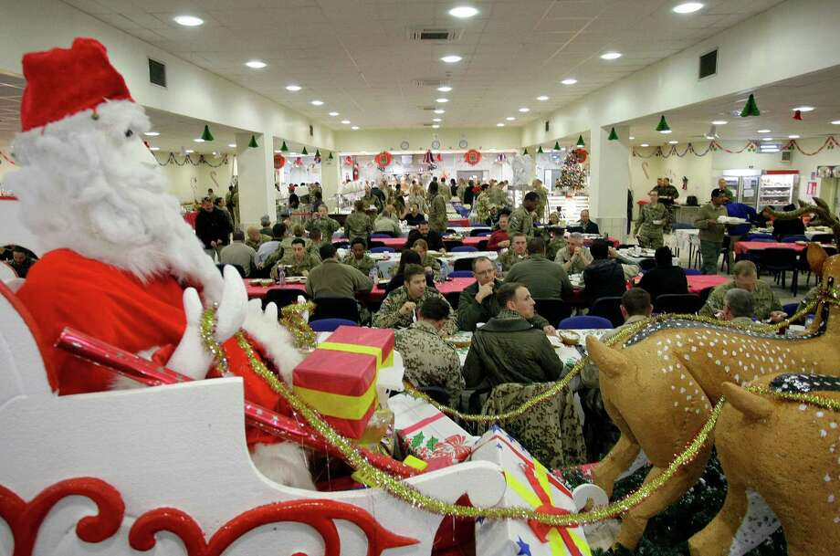 Soldiers and service members with the NATO-led International Security Assistance Force (ISAF) eat Christmas dinner at a dining facility at the U.S.-led coalition base in Kabul, Afghanistan, Tuesday, Dec. 25, 2012. Photo: Musadeq Sadeq, Associated Press / AP